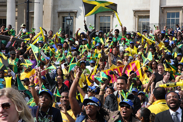 Born Jamaicans, their children(2nd generation Jamaicans) and members of the Jamaican Diaspora celebrate the victory of Usain Bolt and the Jamaican team in the 2008 Olympics held in China.  In Trafalgar Square in England.